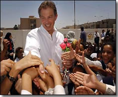 Prime-Minister Blair offers a hand to Basra children